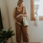 dressing for comfort, camel colored jumpsuit, cotton jumpsuit, white sandals, maternity jumpsuit