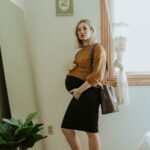third trimester fall outfits, everlane link stitch crew sweater, storq dress, veja sneakers, crocodile purse
