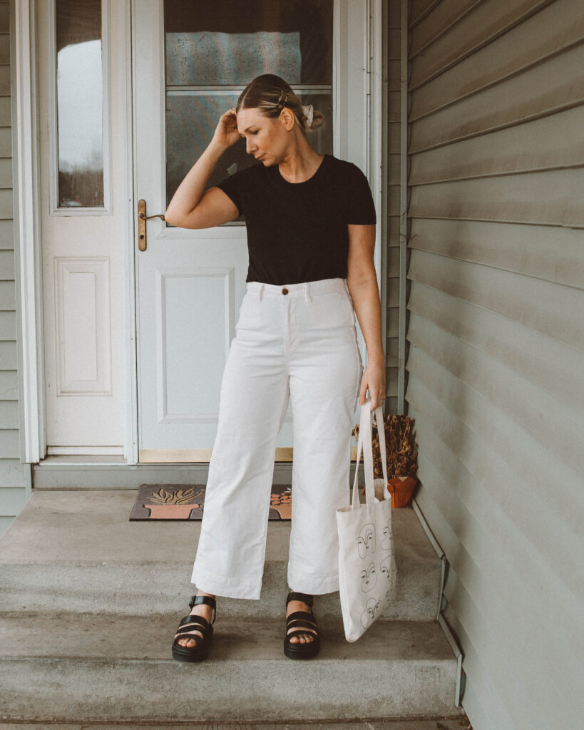 So here's what I actually wore this week, black tee, organic basics, white wide leg pants, gap pants, tradlands tote, dr. marten blaire sandals