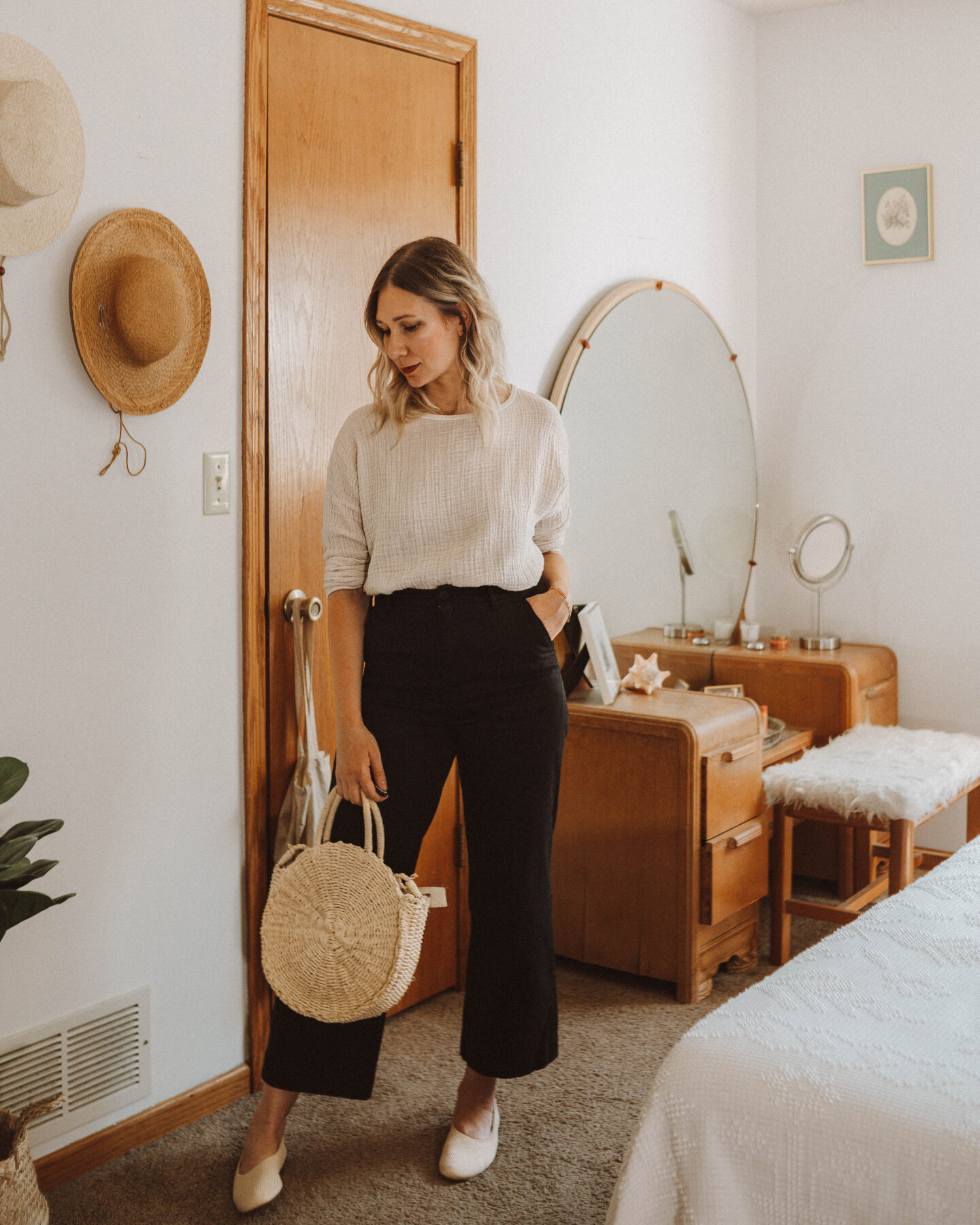 How to Style Wide Leg Pants + 6 Outfit Ideas, it is well la gauze long sleeve top, black kotn cropped culotte pants, everlane reknit day glove shoe, straw circle bag