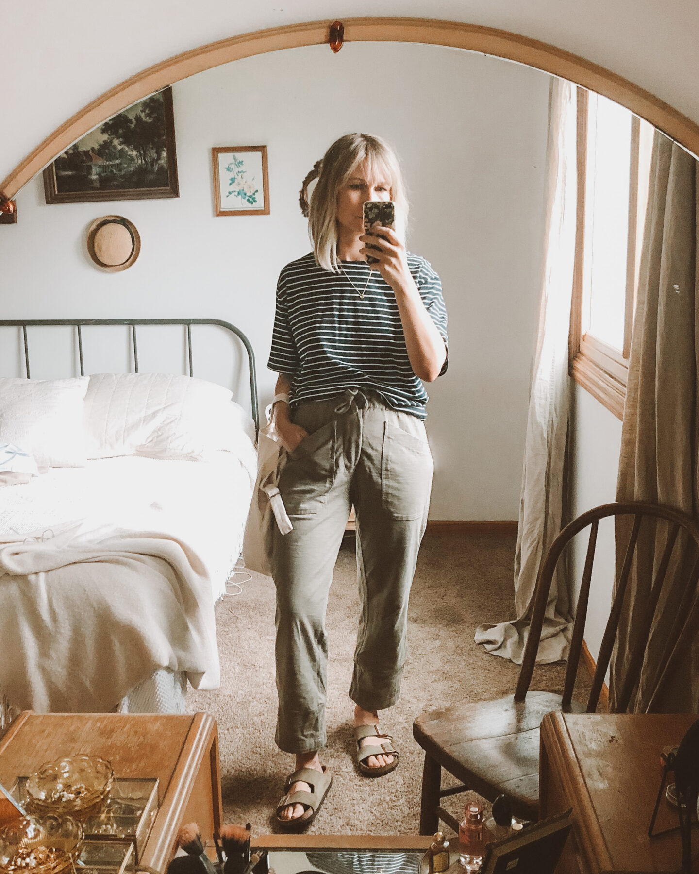 Fall Transitional Dressing: loungewear outfit with a striped navy and white tee, khaki green or olive green sweatpants, and birkenstock arizonas