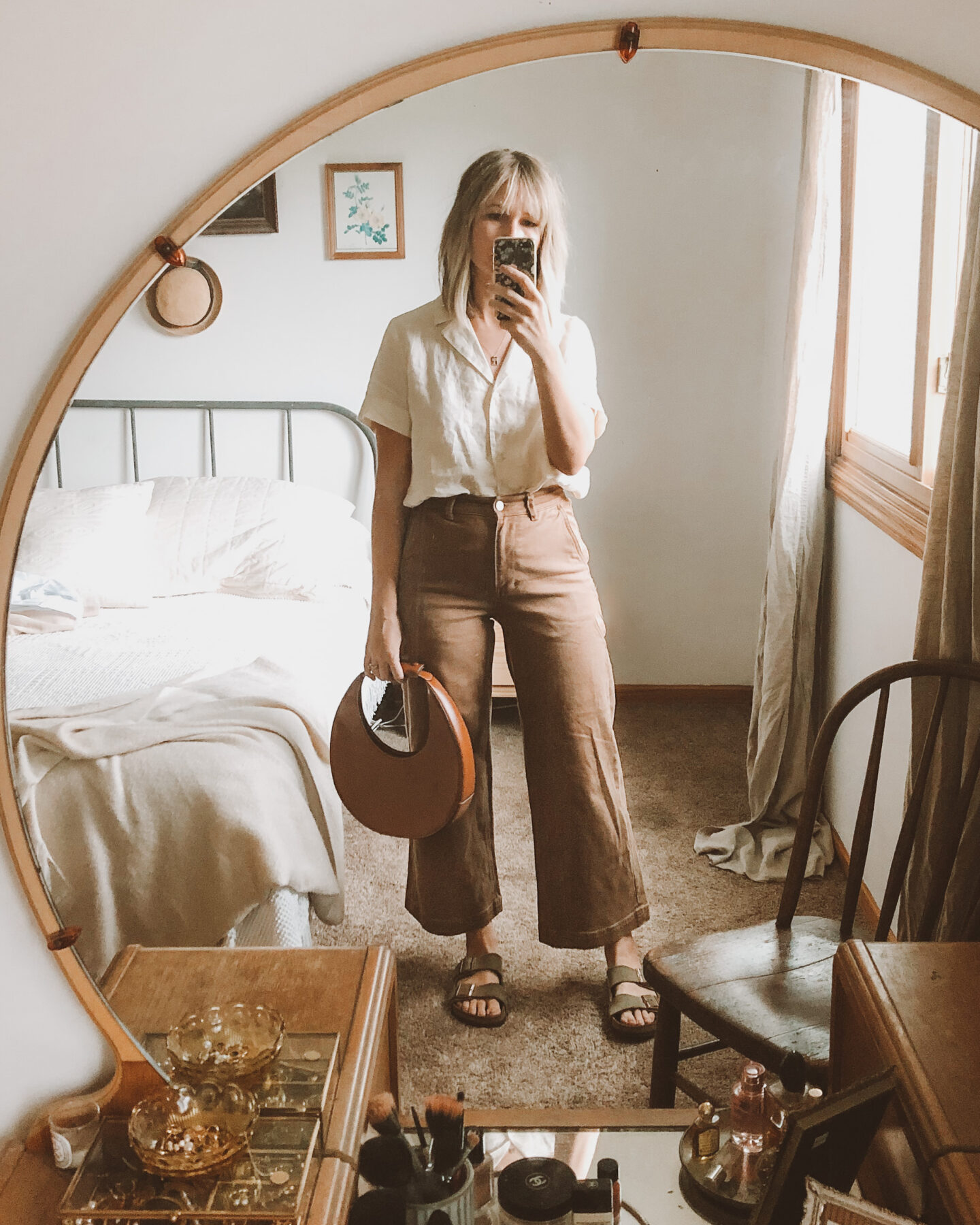 Fall Transitional Dressing: Everlane short sleeve linen notch shirt paired with their wide leg pants in ochre and the staud moon bag with birkenstock arizonas