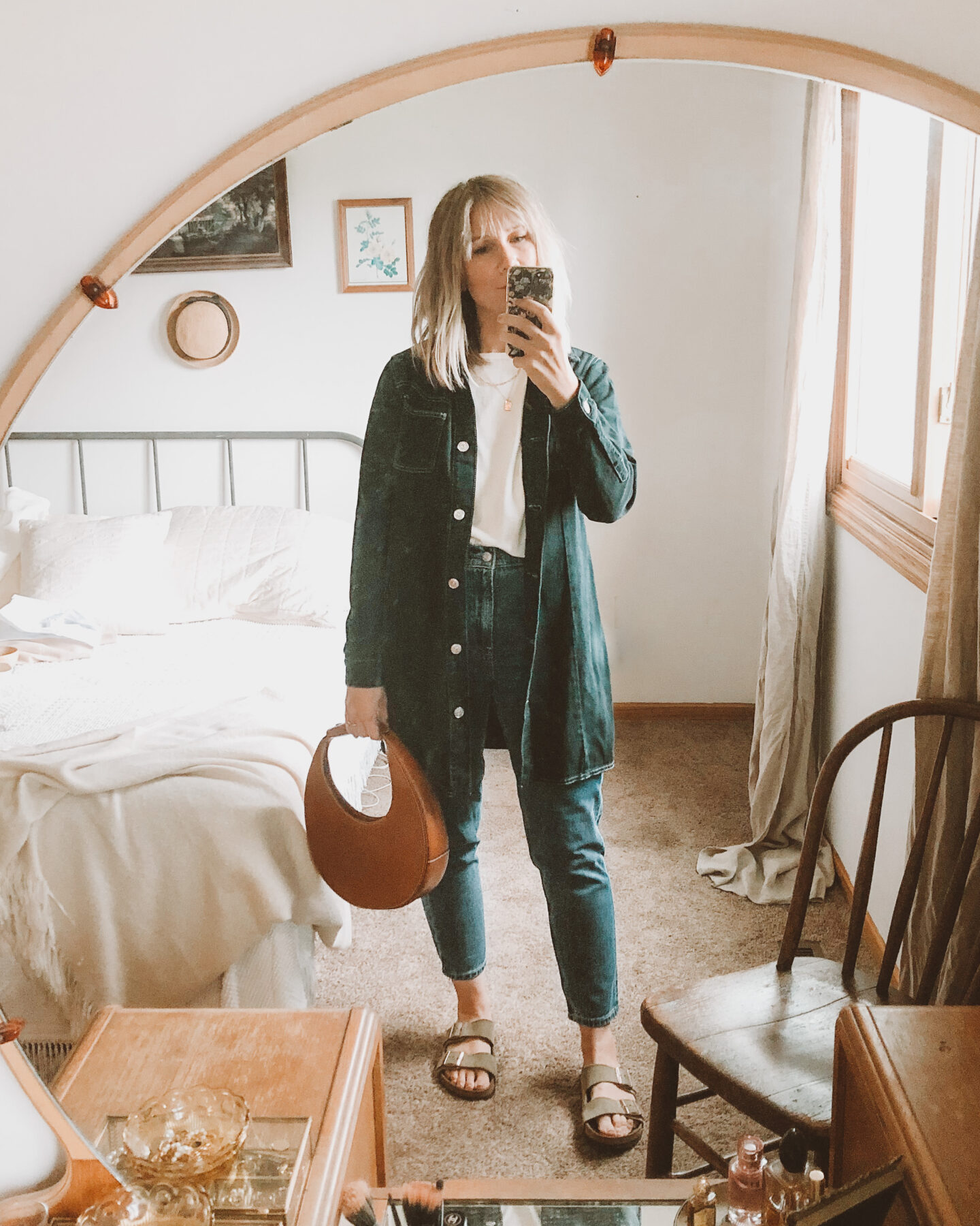 Fall Transitional Dressing: all denim outfit with mom jeans, sweater tee and chore jacket paired with birkenstock arizonas and the staud moon bag which is a circle bag