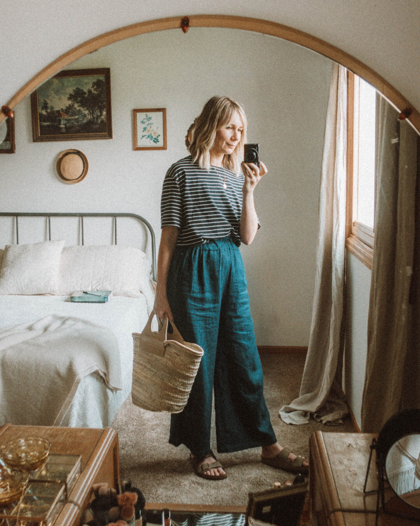 What I Wore this Week: From Tank Tops to Trench Coats, navy and white striped tee, denim wide leg pants, birkenstock arizona outfit, hereu basket bag