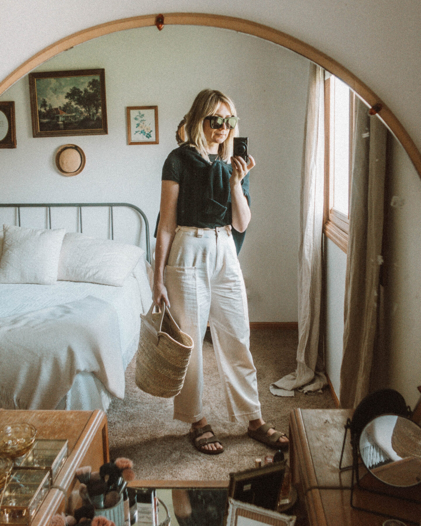 What I Wore this Week: From Tank Tops to Trench Coats, wide leg cargo pants, black tee, black sweater, birkenstock arizona, hereu straw bag, sweater over the shoulders