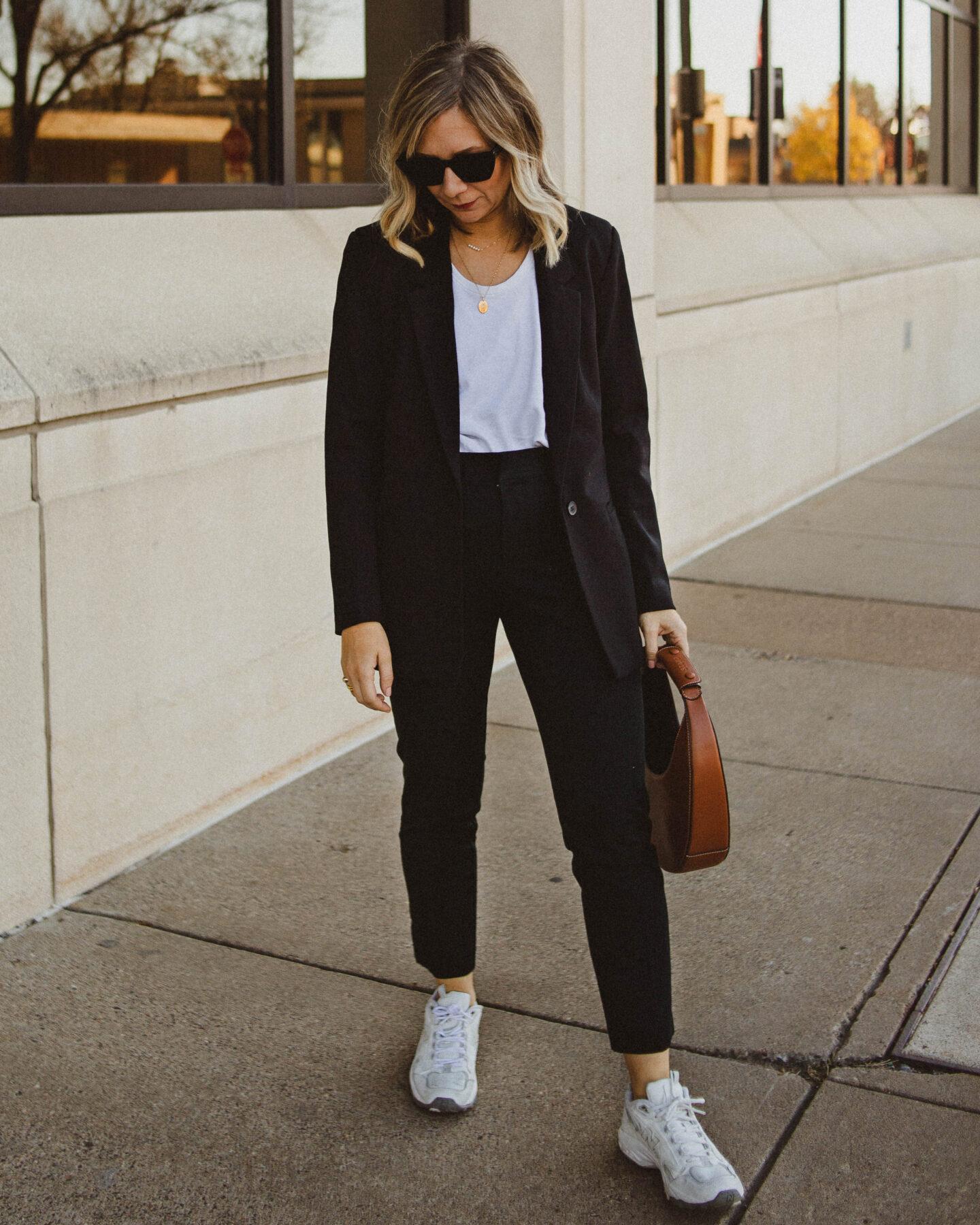 power suit, black boyfriend blazer, black skinny work pants, new balance sneakers, staud moon bag