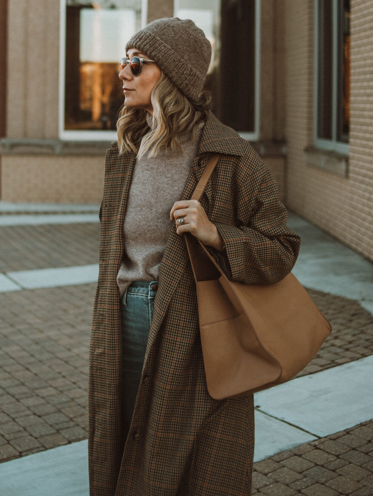 cozy, stay at home outfits madewell perfect vintage jeans, toteme coat, toteme sweater, beige turtleneck sweater, white sneakers, plaid coat, cuyana hobo bag, brown toque