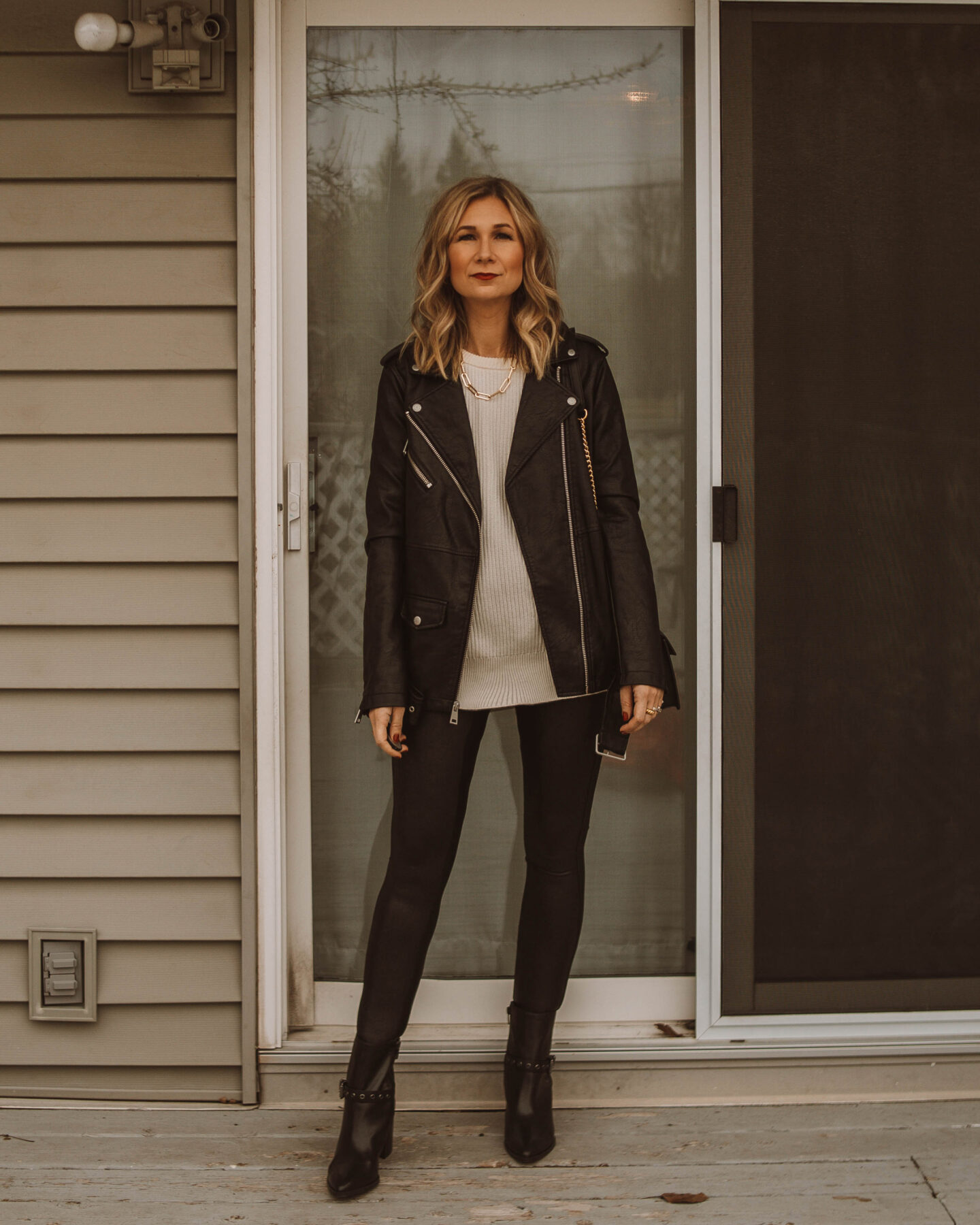 New Years Eve Outfits Feat. Faux Leather Leggings, levi's leather jacket, spanx faux leather leggings, black heeled booties, white sweater