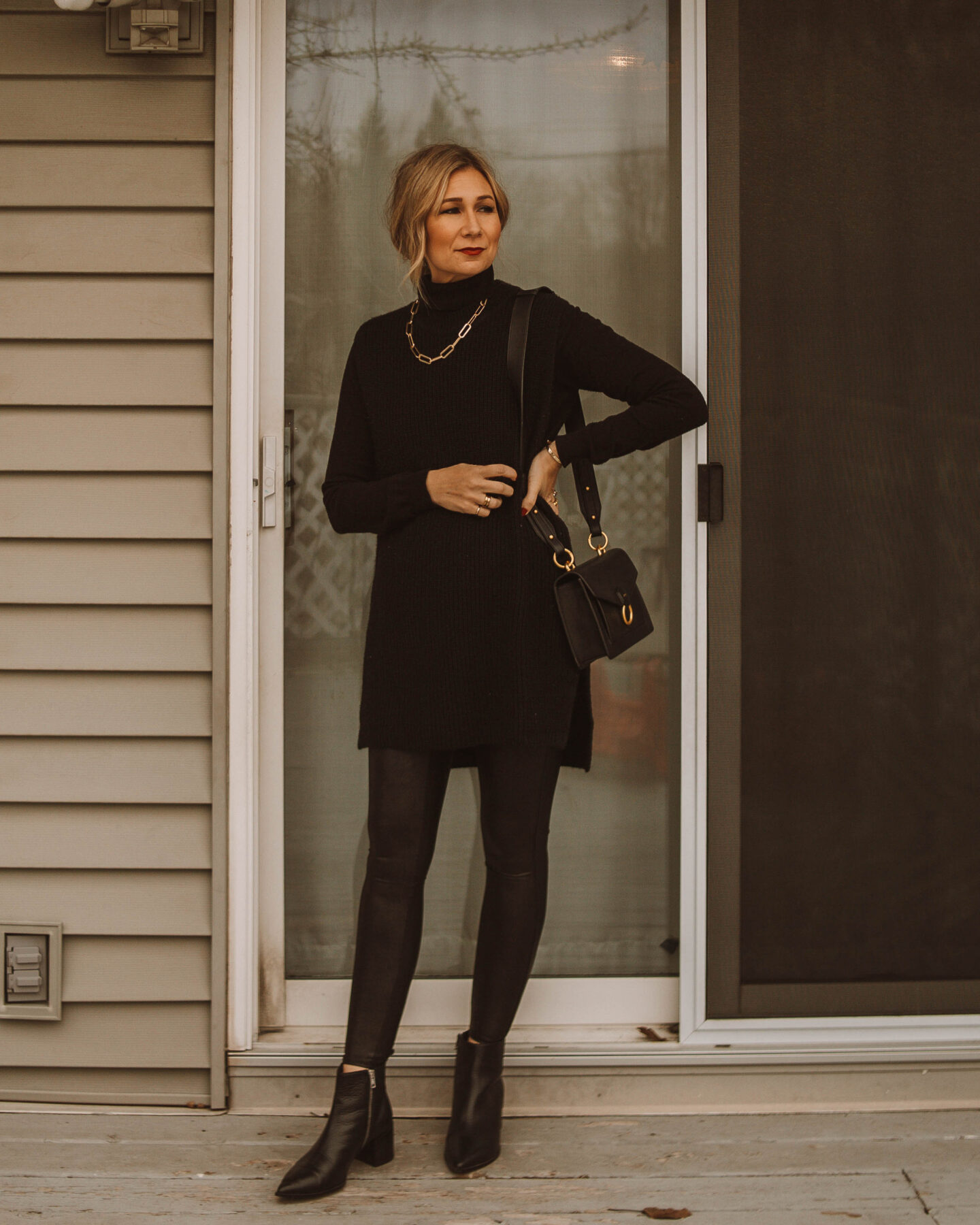 New Years Eve Outfits Feat. Faux Leather Leggings, black turtleneck, black sweater vest, black booties