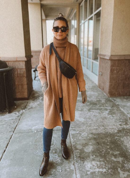 camel duster cardigan, camel turtleneck sweater, dark wash skinny jeans, snakeprint boots