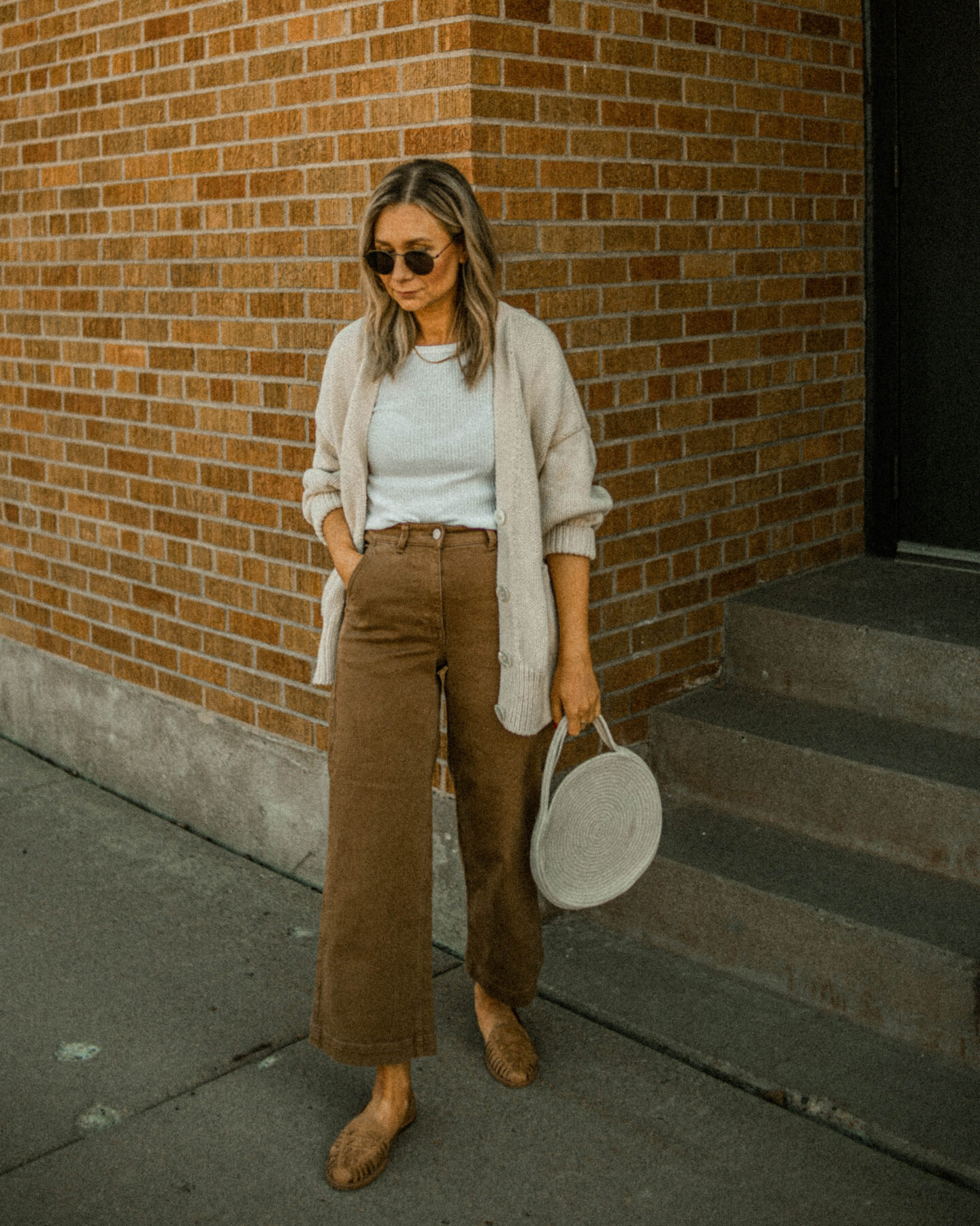 wide leg pants, ribbed white tee, babaa cardigan, oversized sweater, nisolo huarache sandal, brown sandals, white rope bag