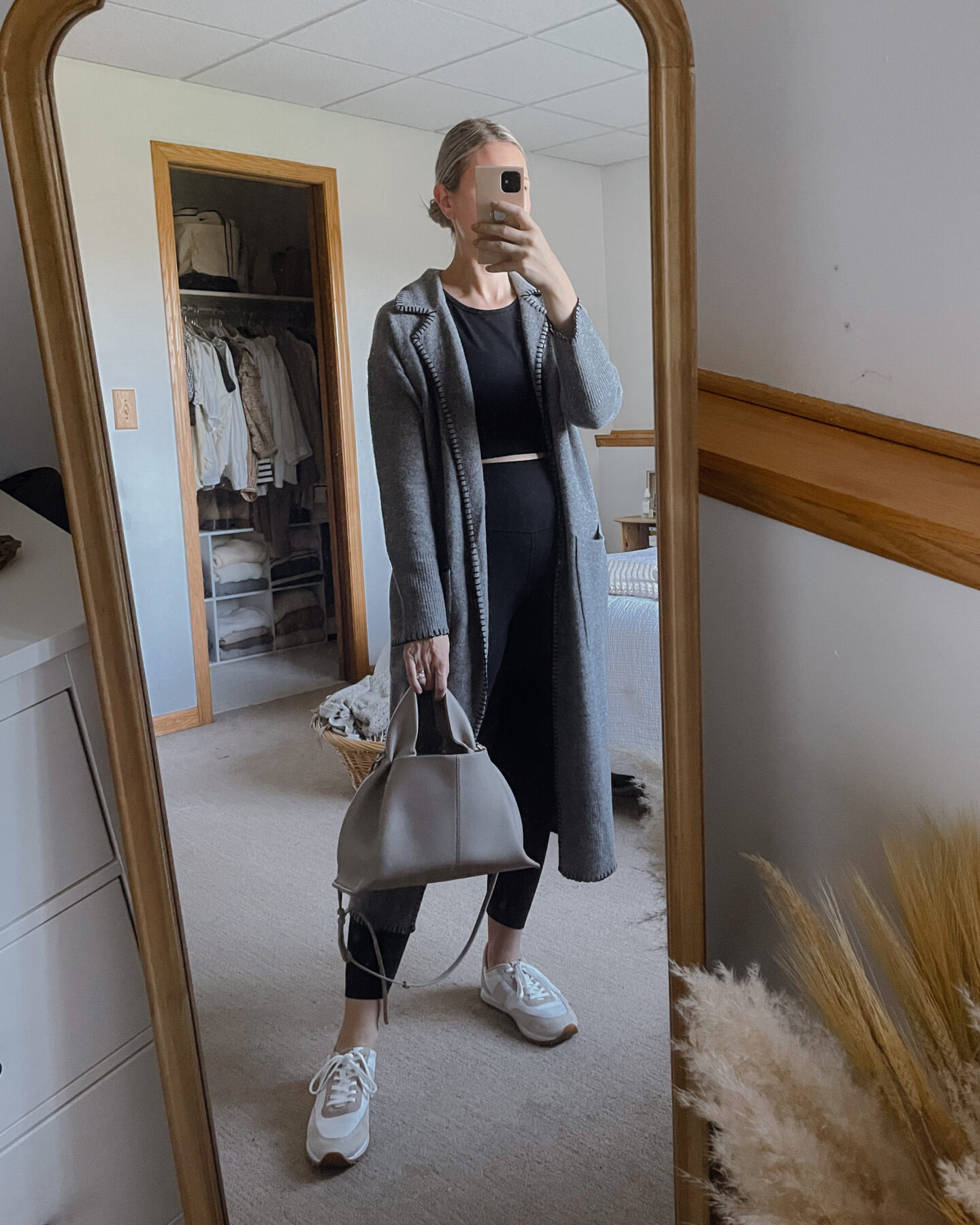 Karin Emily wears a girlfriend set with gray J. Crew sweater coat, sneakers, and a polene numero neuf bag